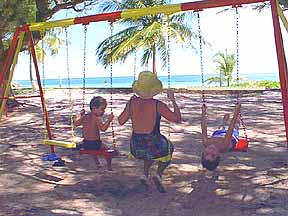 Children swings in the play area at silver sand
