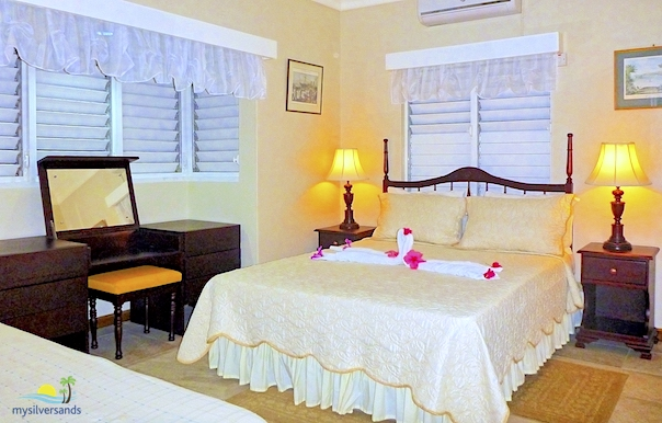 Bedroom Two At Queenu0027s Cottage Is Air Conditioned. It Is Furnished With A  Queen Size Bed. It Is Quite Quite A Spacious Bedroom With Lots Of Louvre  Windows ...