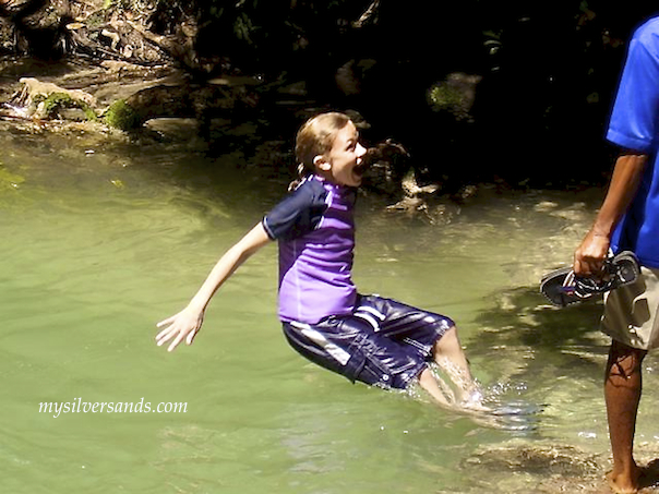 child falling in dunns river falls jamaica