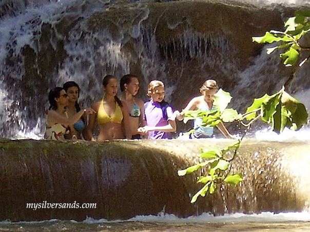 family in pool at dunns river falls jamaica