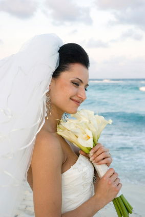 bride with wedding bouquet by the sea