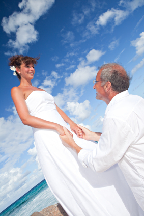 bride and mature groom by the sea for destination wedding