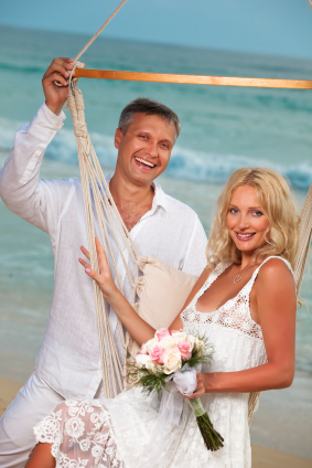 mature couple relaxing on beach destination wedding