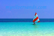 sunfish sailboat sailing into silver sands jamaica