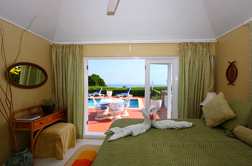blue vista villa,silver sands jamaica, master bedroom with pool and sea view