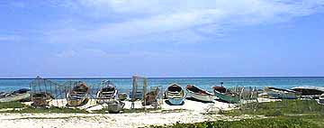 at the fisherman's beach, the boats and fish pots are lined up on the store
