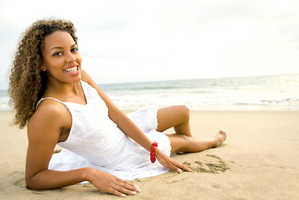woman lying barefoot on the beach