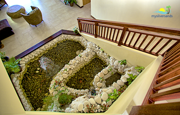 fish pond beside the stairs