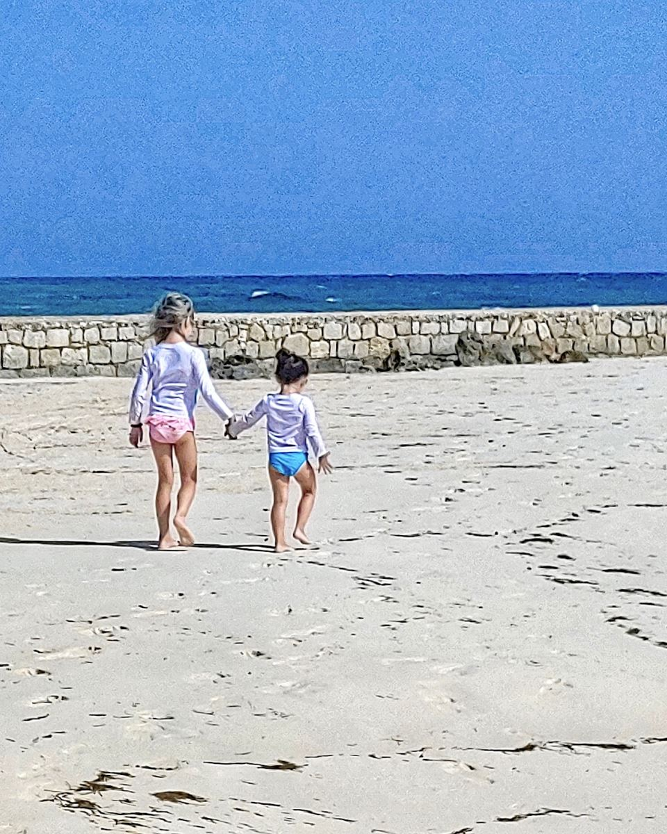 two sisters walking on the beach
