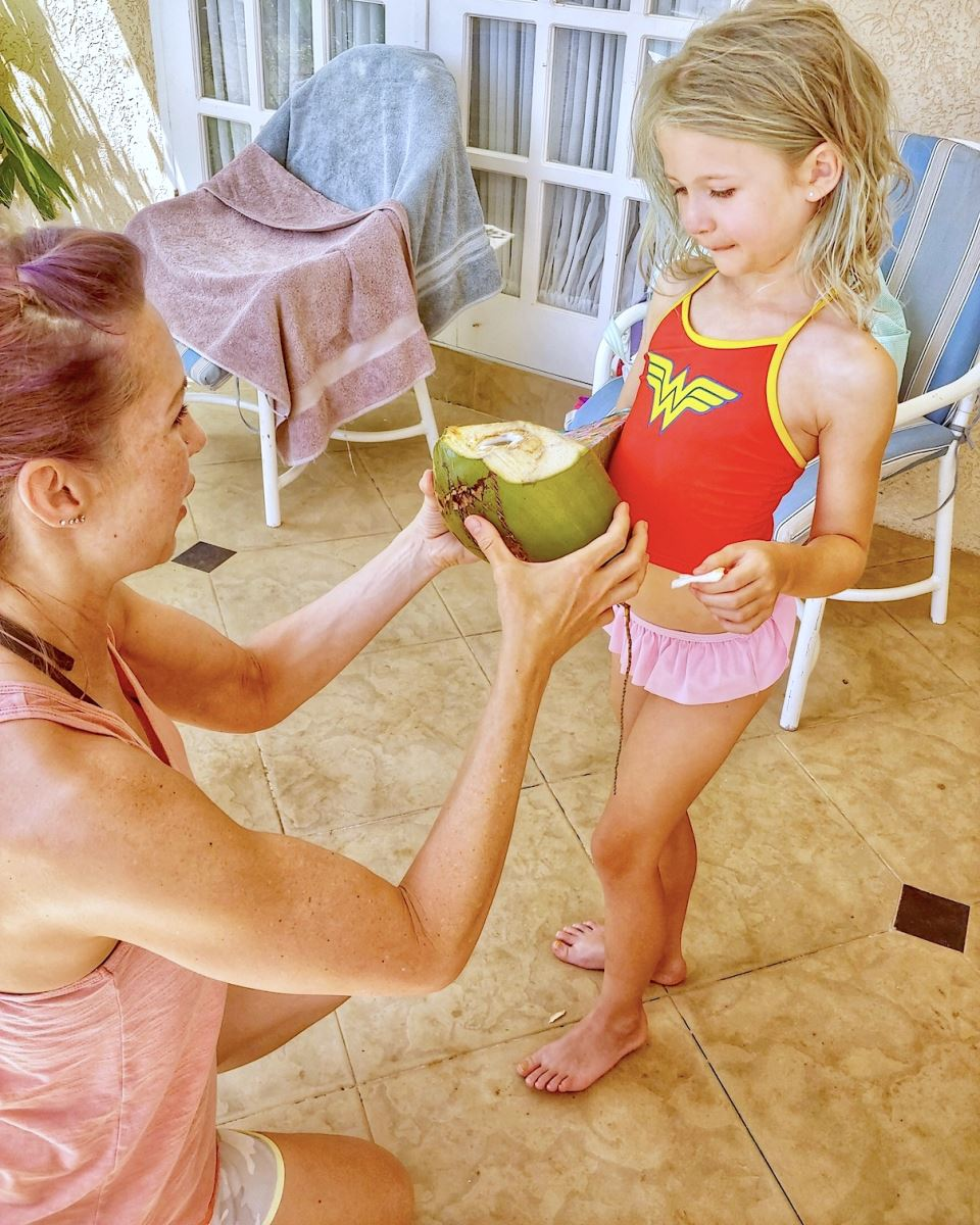 mother and daughter  with coconut