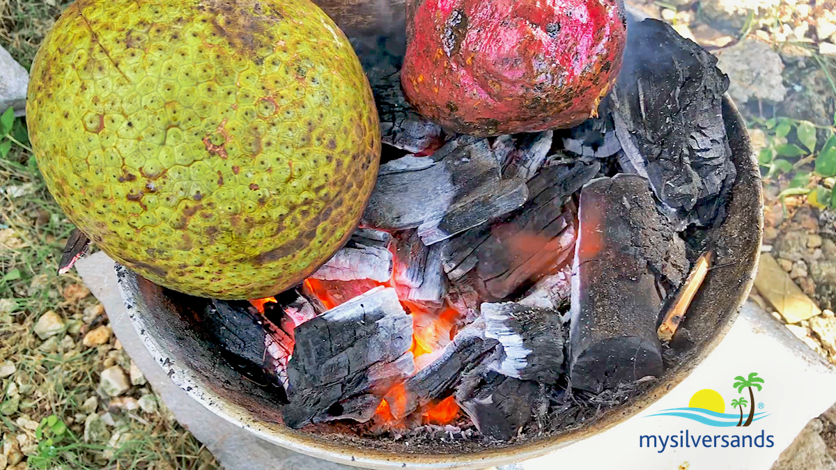 breadfruit  and sweet potato on the coal fire