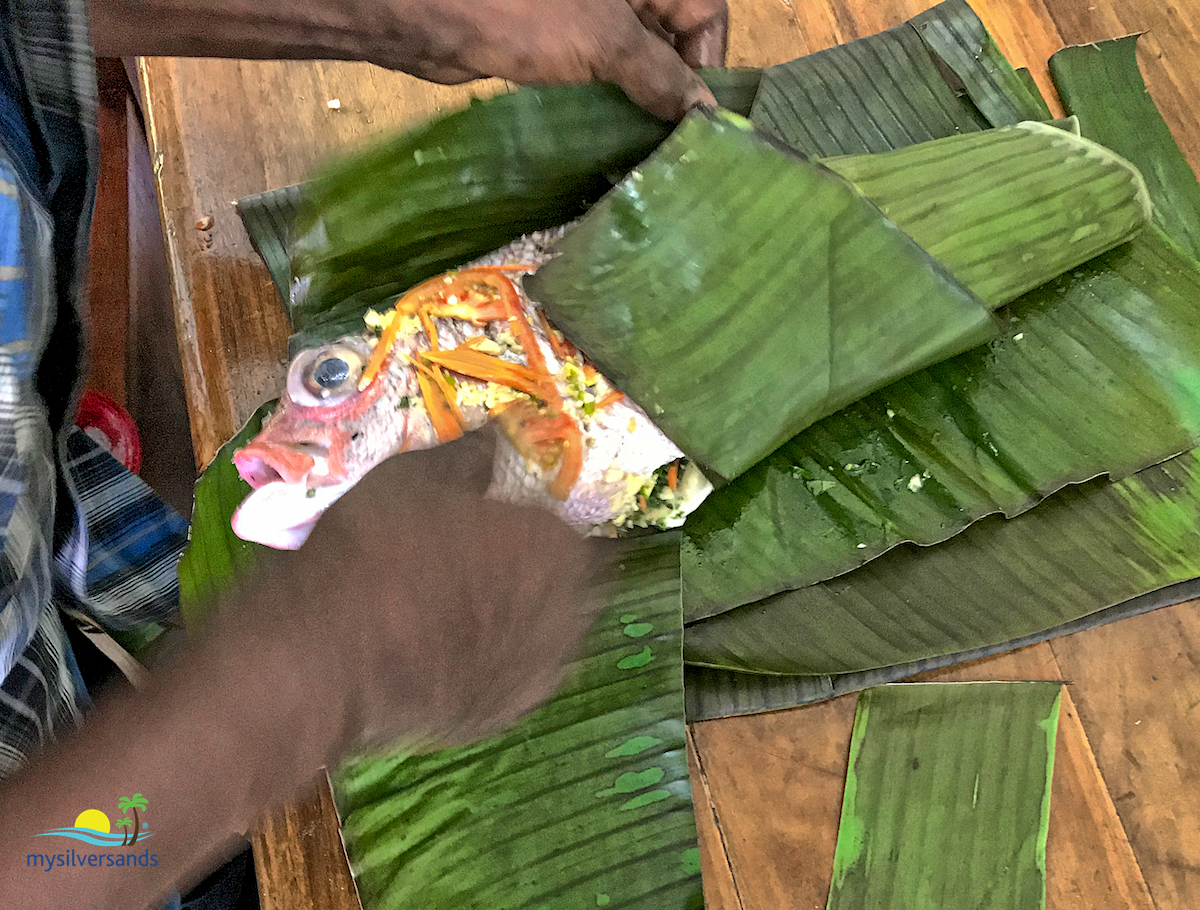 wrapping the fish in banana leaf