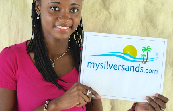 Rep holding mysilversands sign with logo