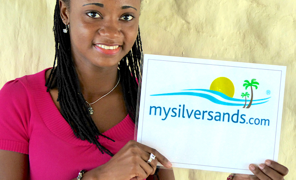rep holding mysilversands sign