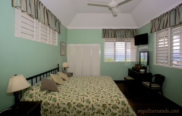 bedroom two of honeycomb villa with king size bed