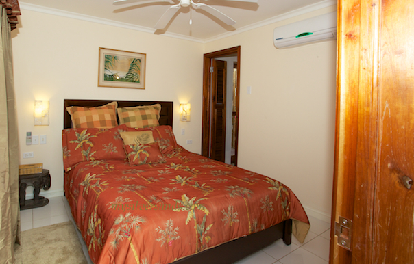 bedroom four of blue vista is furnished with a queen size bed