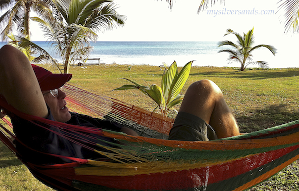 geoff gibson relaxes in hammock on the beachfront at endless summer in silver sands villas jamaica