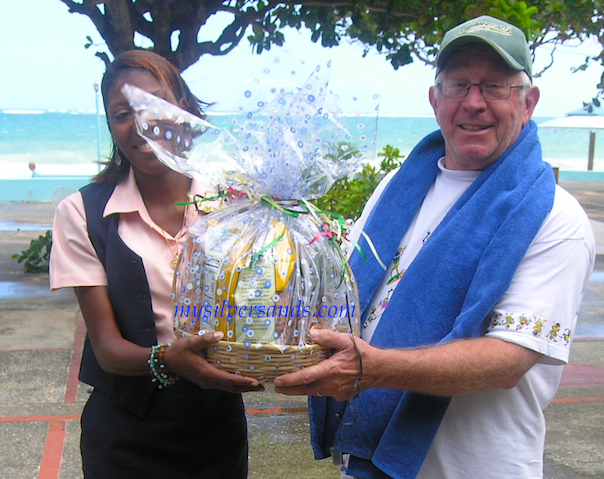 kimesha presents gift basket to vincent foltz at silver sands villas jamaica