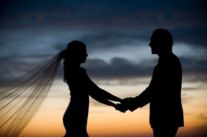 newlywed couple at sunset after destination wedding