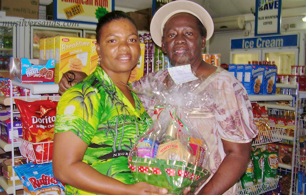 constance of tu mac villa in silver sands jamaica receiving her christmas gift basket