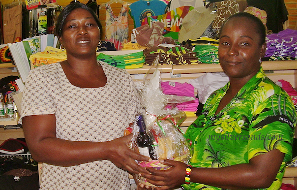 Ingrid of Hang Time with Arlene from Villa Mart receiving her gift basket at Silver Sands Jamaica