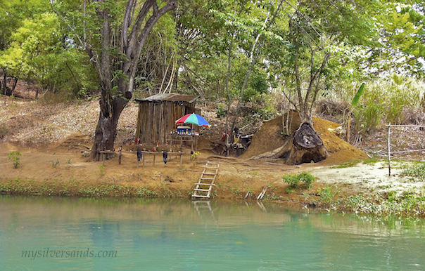 shop on the bank of the martha brae river in jamaica