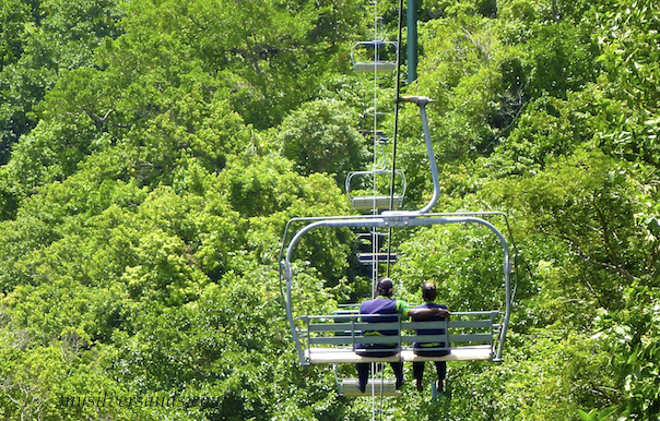 riding the chair lift to the mystic mountain attraction