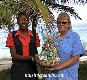 kimesha presents pam sperry with a gift at queen's cottage at silver sands jamaica