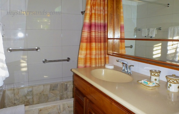 bathroom en suite of master bedroom at roots cottage in silver sands villas