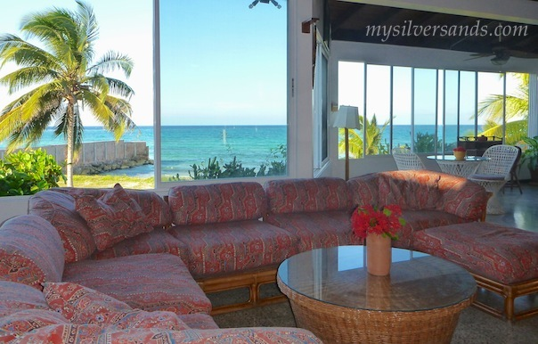 living room with sea view at roots cottage in silversands jamaica