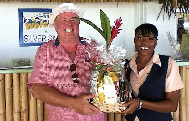 karl eibensteiner welcomed by tanesha, mysilversands rep, with a gift