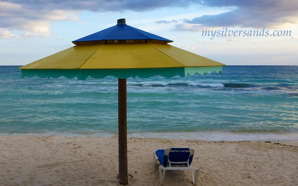 yellow beach cabana and lounge chair at silver sands villas jamaica
