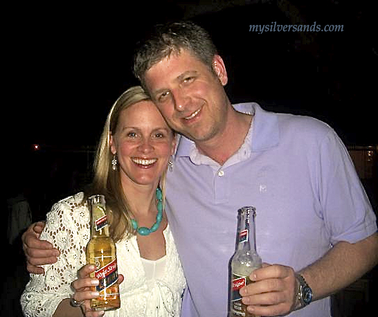 peter and lara neal at silver sands villas welcome party